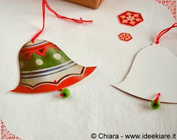 biglietto natalizio a forma di campana con batacchio fatto con perlina di legno