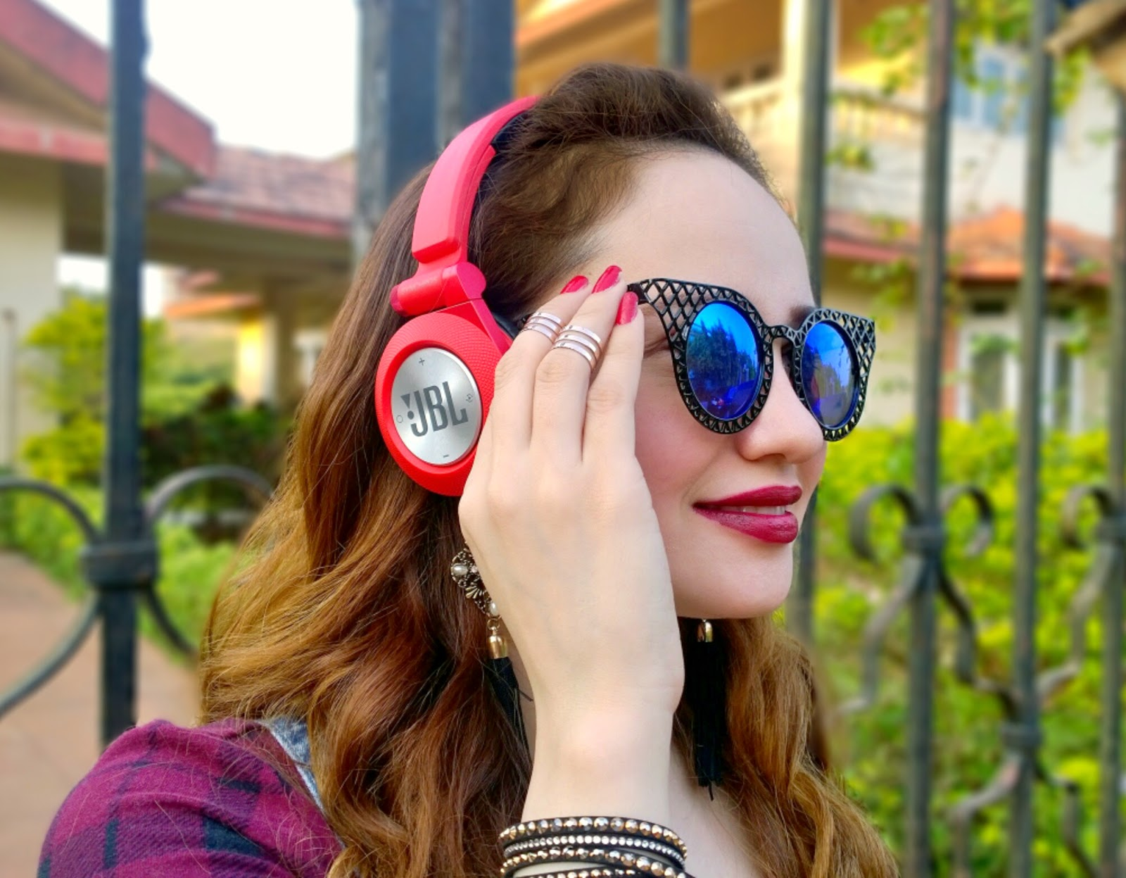 Candy Red JBL Wireless Headphones, Cat Eye Sunglasses, Midi-rings, MAC Diva Lipstick