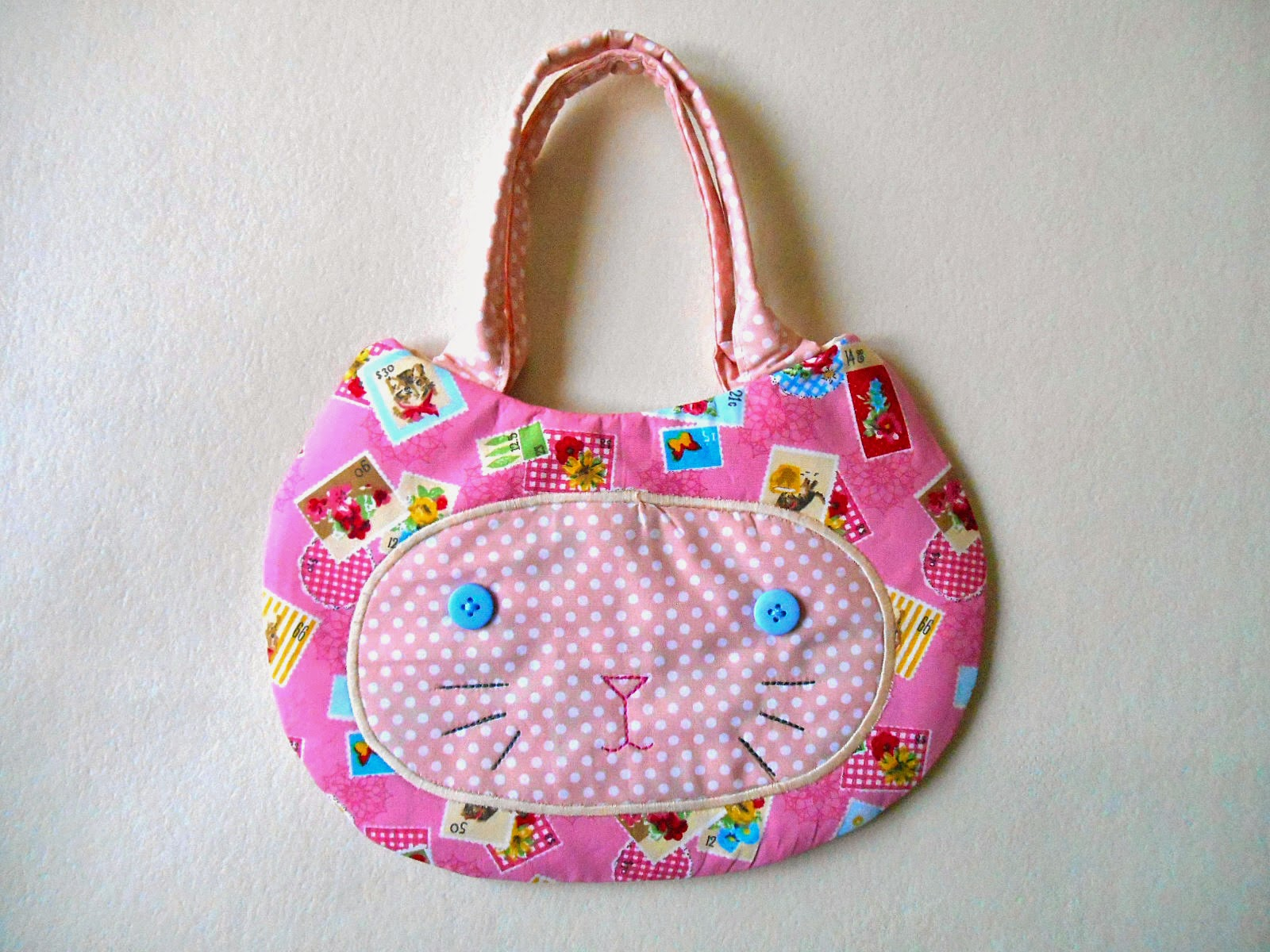 pink stamps cat face purse front