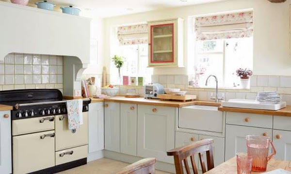 Country cottage kitchen - i love all the pastel accessories, light blue le creuset casserole dishes and those floral blinds