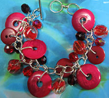 Bracelet has Bright Red Buttons and Beads Hanging in Pretty Charm Style Design