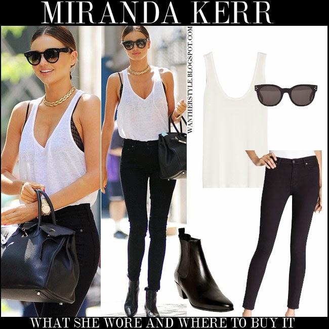 Kerr in white tank top, black bra, black