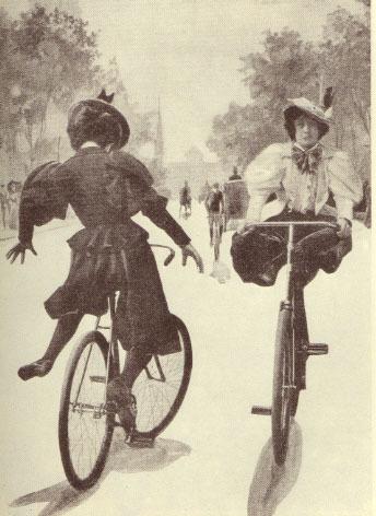 Femmes en bloomers à vélo.