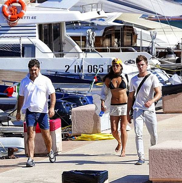 Still on her Black Bikini, the 35-year-old changed her lonely holiday to joined with Zac Efron and Italian businessman, Gianluca Vacchi as they was pictured to relaxing on the yacht in Sardinia, Italy on Wednesday, July 2, 2014.