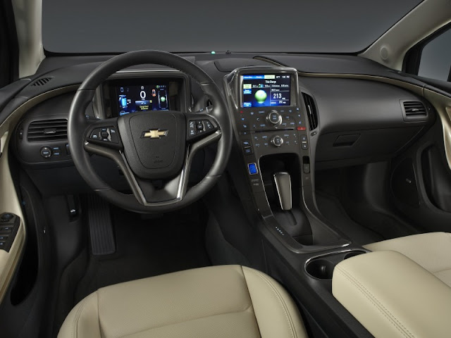 Black interior of 2012 Chevrolet Volt featuring digital gauge cluster and multi-function display screen