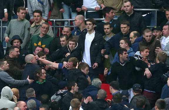 Trouble breaks out between Millwall supporters during their FA Cup semi-final against Wigan