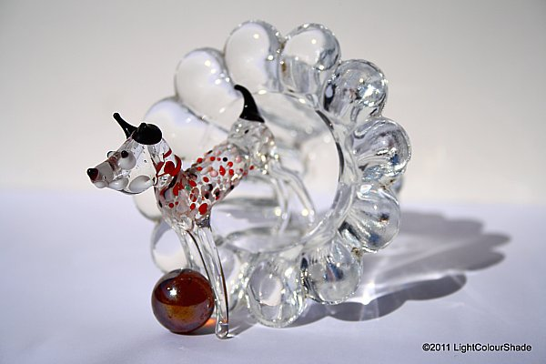 Glass dog with a ball
