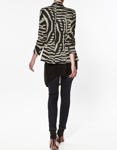 Look at the back! Beautiful panelled zebra print with frill on bottom ...