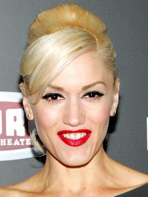 Side-slicked bangs and teased volume on top make Gwen Stefani's ponytail look super-glam.