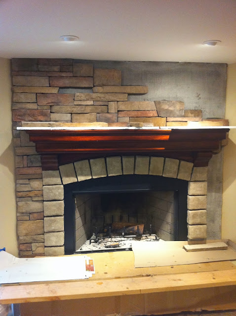 corner stone fireplace during construction www.goldenboysandme.com