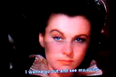 "Scarlett O'Hara looking mad with the caption ""I wanna go out and see my pony."""
