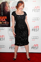 Christina Hendricks strikes a fierce pose on the red carpet