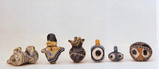 A collection of New Kingdom sand-core glass beads from the Amarna period. For right eye bead: diameter 1.5 cm. Collection Henry Anavian, New York
