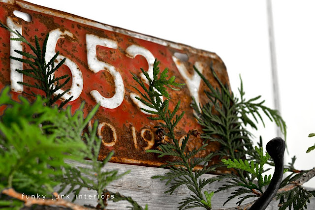 Red rusty license plate for Christmas inspiration via Funky Junk Interiors