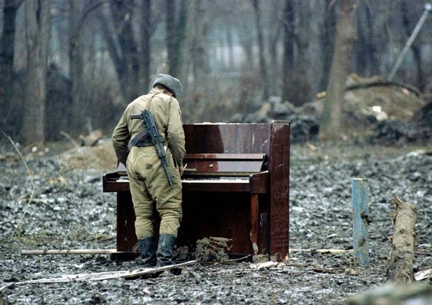 Russian soldier playing an abandoned piano