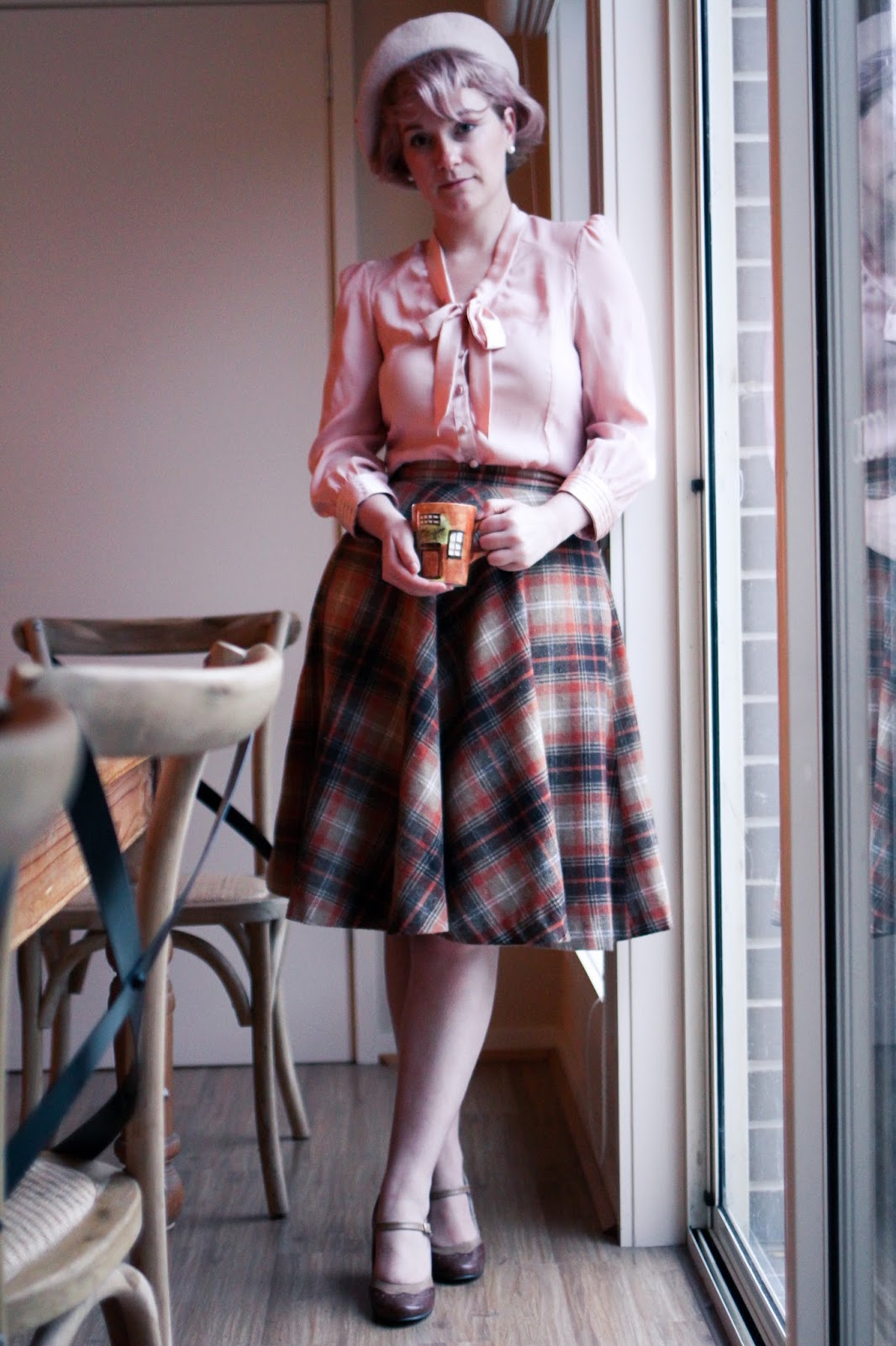 Liana of Finding Femme in Review pink 'money penny' pussy bow blouse, orange tartan Modcloth circle skirt and Modcloth wedge heels with pink felted beret.
