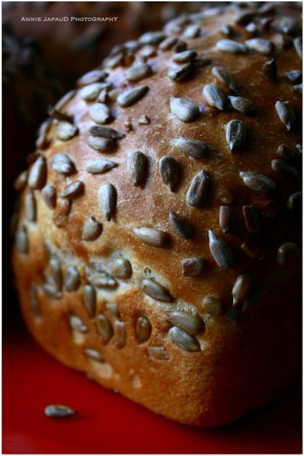 close up of a milky white bread with sunflower seeds on top