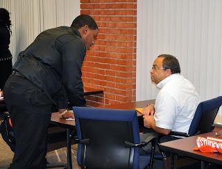 NABCJ President Jamal Turner confers with SHSU Employment Specialist Greg Monteihl