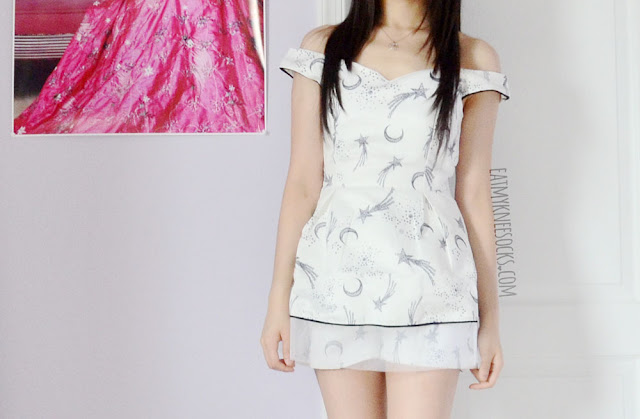 The moon and stars boat-neck top and shorts co-ord from SheIn, modeled after the La Boutique romper.