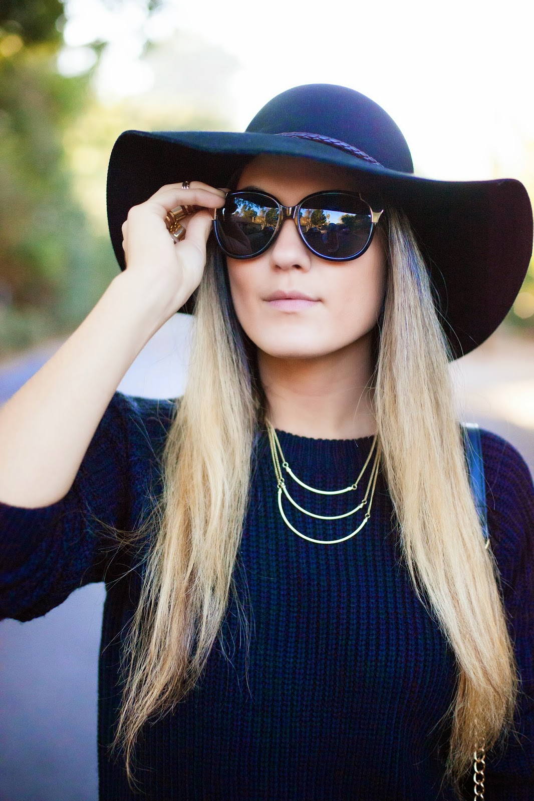 black knit sweater and hat