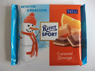 Christmas editition of Ritter Sport containing a caramel and orange flavour cream filling