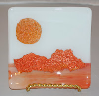 small plate with mica sun and mountains