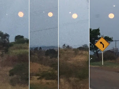 UFO Caught Flying Past Super Moon 2015, UFO Sightings