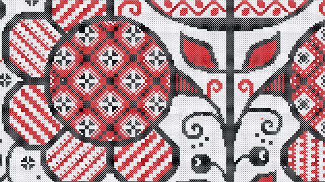 фрагмент вышивки крестиком в красно-черном цвете