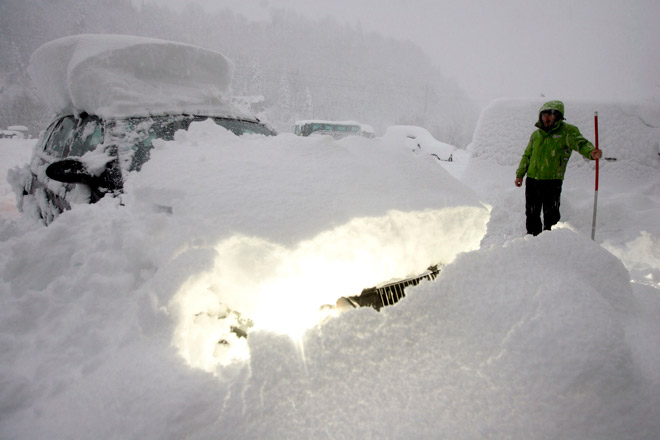digging car in snow in siberia