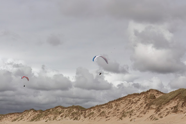sand dunes, amazing sky and two kite flyers