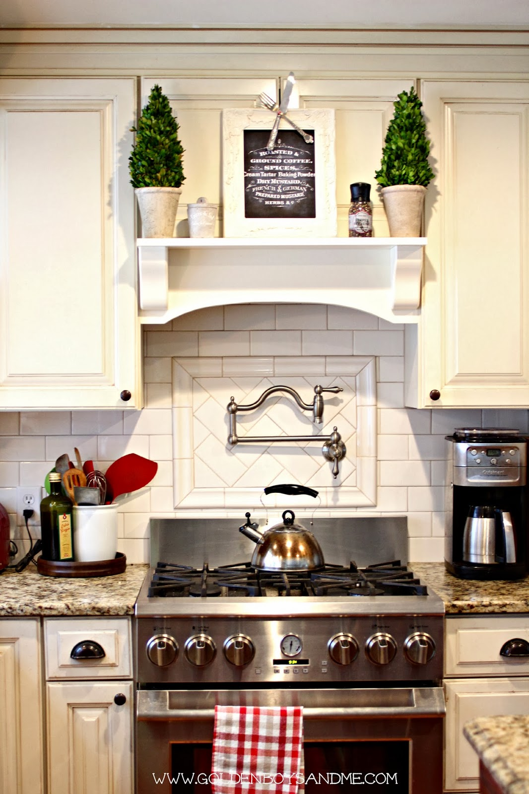 diy range hood mantel with stainless pot filler and white subway tile backsplash | www.goldenboysandme.com
