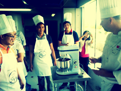 Chef teaching guys how to make chocolate mousse