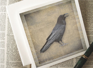 Raven card, a solitary raven with each feather in exquisite detail is printed on a background texture with the look of old linen.