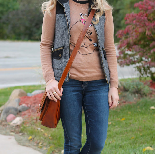 Fox graphic sweater paired with tweed vest, jeans and leopard flats