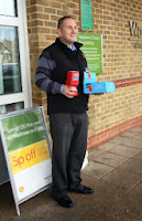 Simon Densley outside Waitrose Worcester Park selling poppies