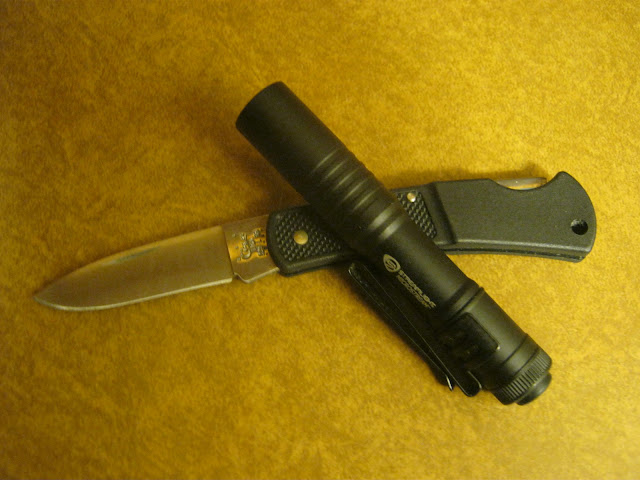 Streamlight Microstream AAA Flashlight shown with Case 155 Lockback pocket knife
