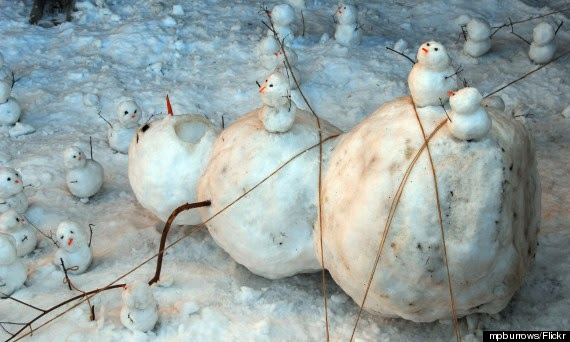A lot of snow monsters and their victim.