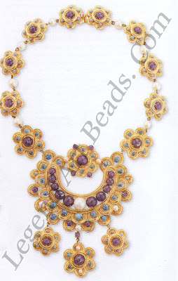 """This necklace draws its inspiration from ethnic themes and is marked """"Dior"""". Faux lapis lazuli and turquoise are arranged in floral and crescent forms."""