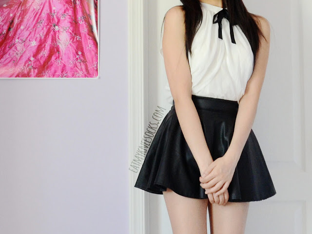 A cute, ulzzang-inspired black-and-white outfit featuring Dresslink's ribbon-tied blouse and a black faux leather skater skirt.