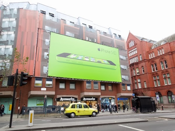 Giant green iPhone 5c billboard London