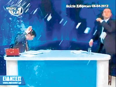 VOURHAS (kiri) cuba mengelak balingan telur dan yogurt di studio televisyen Epiros TV1 di Ioannina, utara Greece pada Jumaat lalu.
