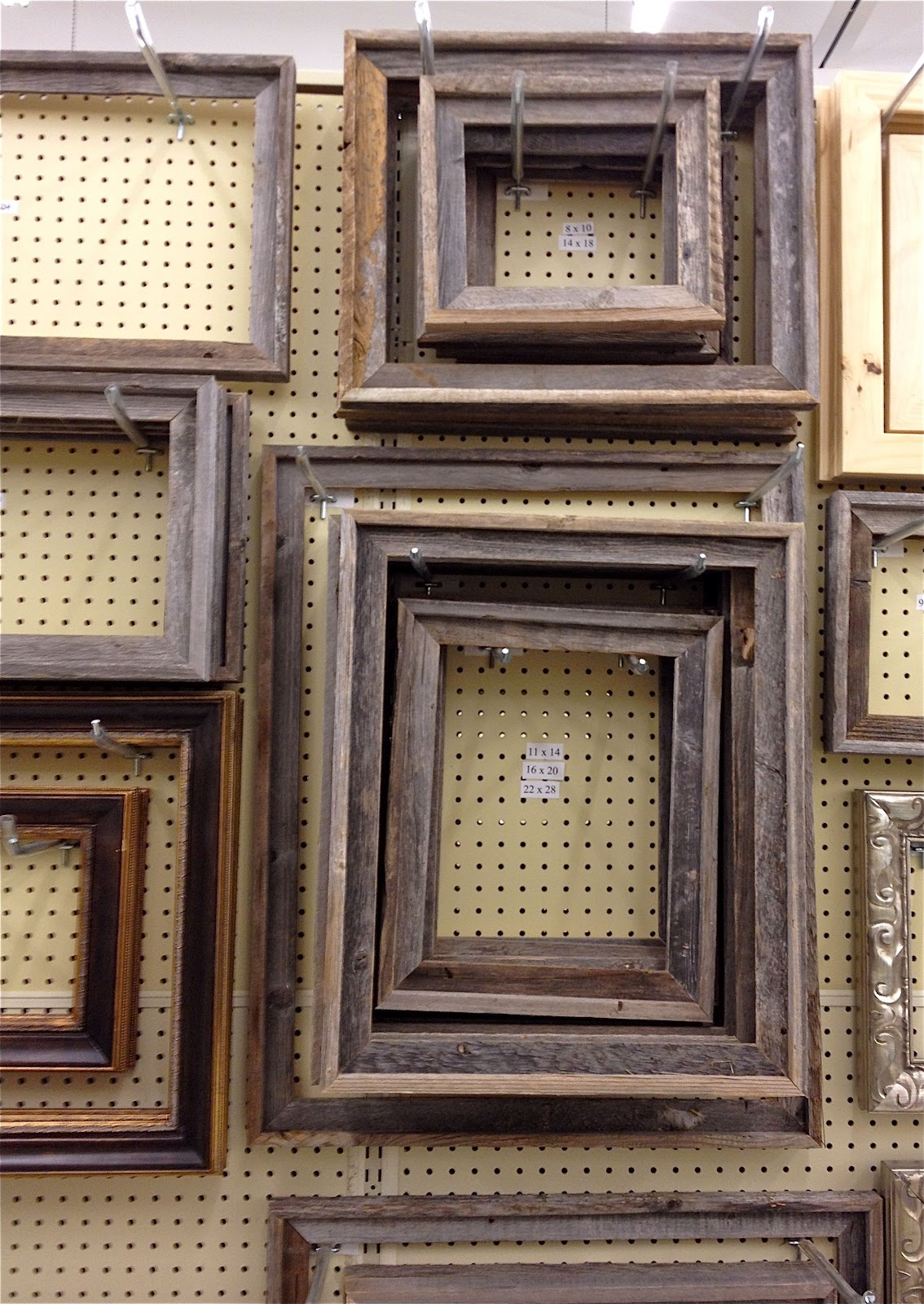 heres a close up with a sneak peek preview of one of my bulletin boards to show you the reclaimed wood look of the frames complete with old nail holes