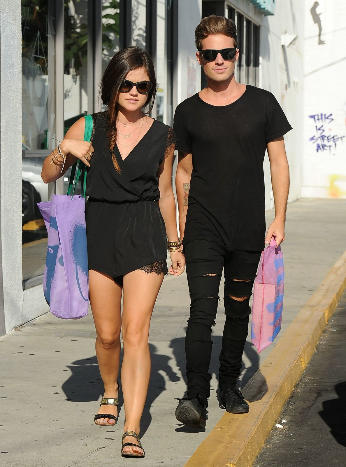 Lucy Hale shops in a lace accented black romper with her boyfriend in Beverly Hills