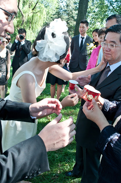 Bride and Groom serve tea for Chinese Tea Ceremony at Central Park