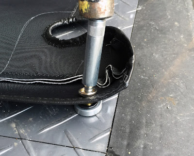 Fitting the poppers to the boot cover using the dot fastener tool