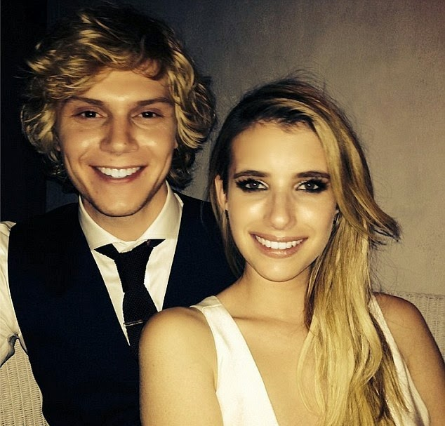 Evan Peters with his wife