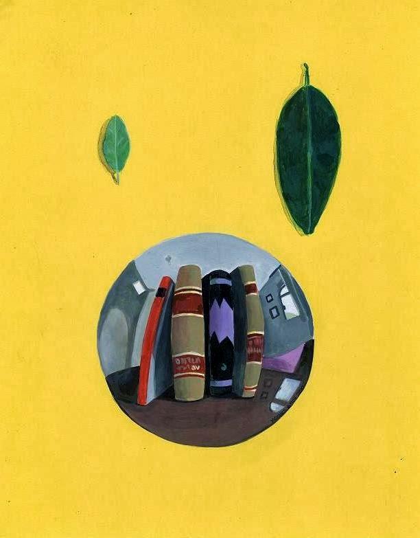 Libros y dos hojas de mandarina