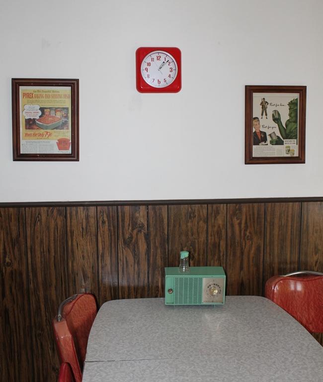 vintage ads hanging in a retro kitchen