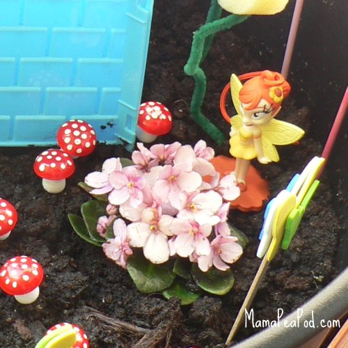 imaginary play making fairy garden flowers