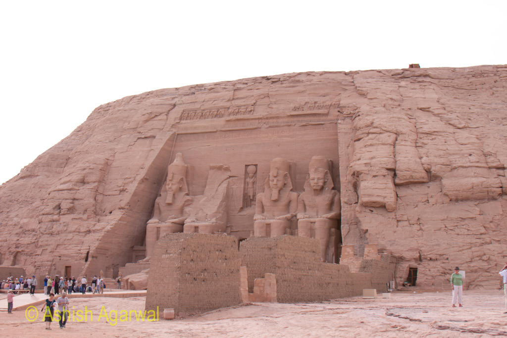 View of the statues outside the Abu Simbel temple along with tourists